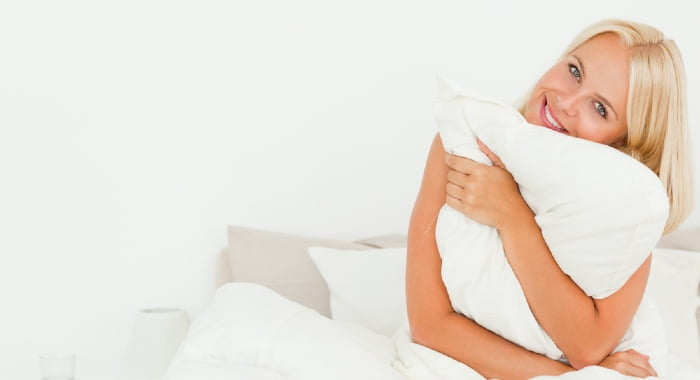 As front sleeping isn't the best option for your spine, the least you can do is trying to get rid of the pillow entirely.